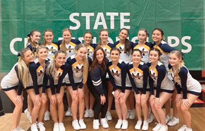 Colville Tribal member Darah Swan, top right, stands with her teammates at the WIAA State Cheerleading Championship in February. Mead placed third in the 4A Non-Tumbling Medium in only their second year of competition.