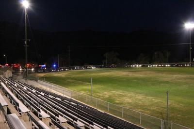 """The Lake Roosevelt High School ball fields shine bright at 8:20 p.m., April 17, as the school participates in the """"Be the Light"""" campaign to honor senior students and student-athletes."""