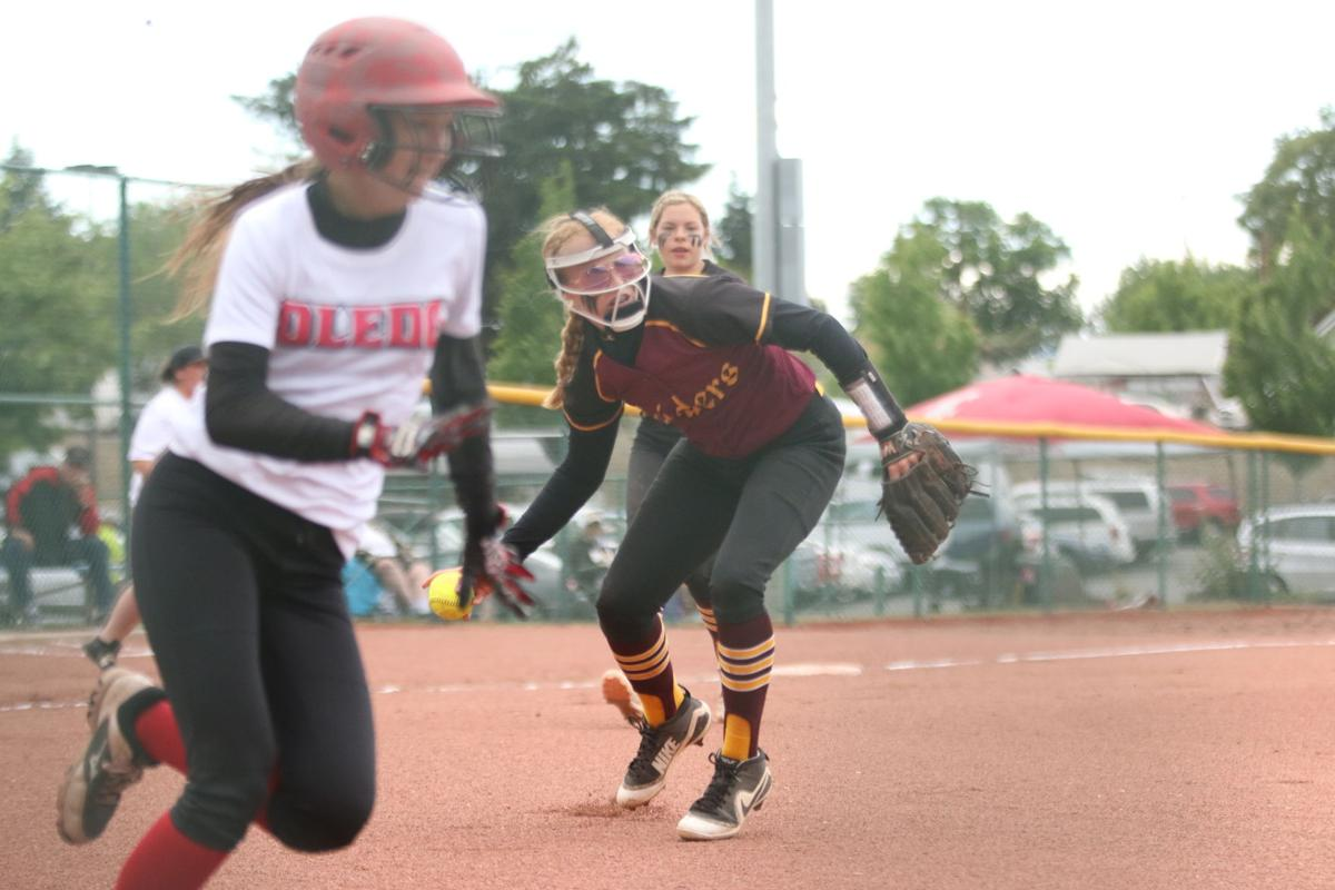 Emma Marchand of Lake Roosevelt fields a ground ball against Toledo on May 24 at the 2B girls softball state tournament
