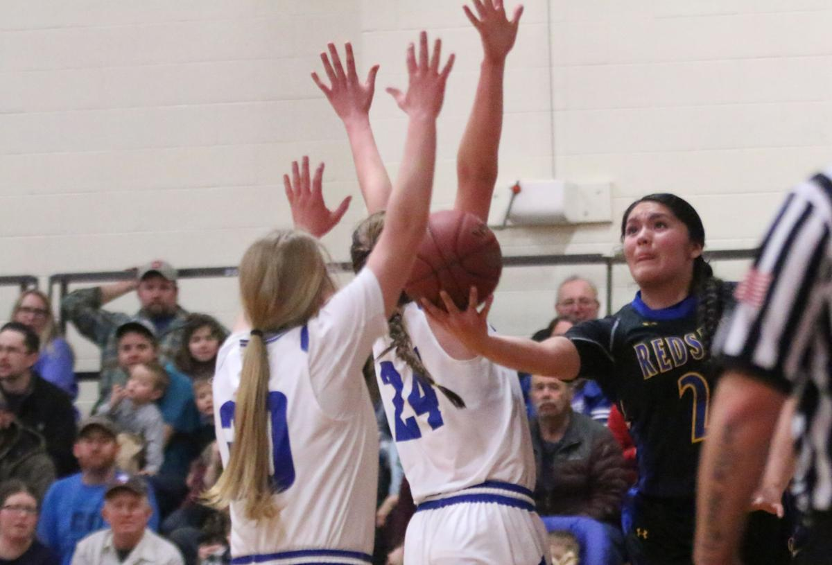 Christina Flett (Colville tribal member) of Wellpinit (#24 black) drives to the hoop against Curlew on Tuesday evening in the first round of the District 7 1B Playoffs.