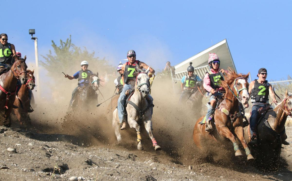 Jockies and their horses reach the mid-point of the Suicide Race Hill during the second elimination race on Sunday afternoon (August 5)