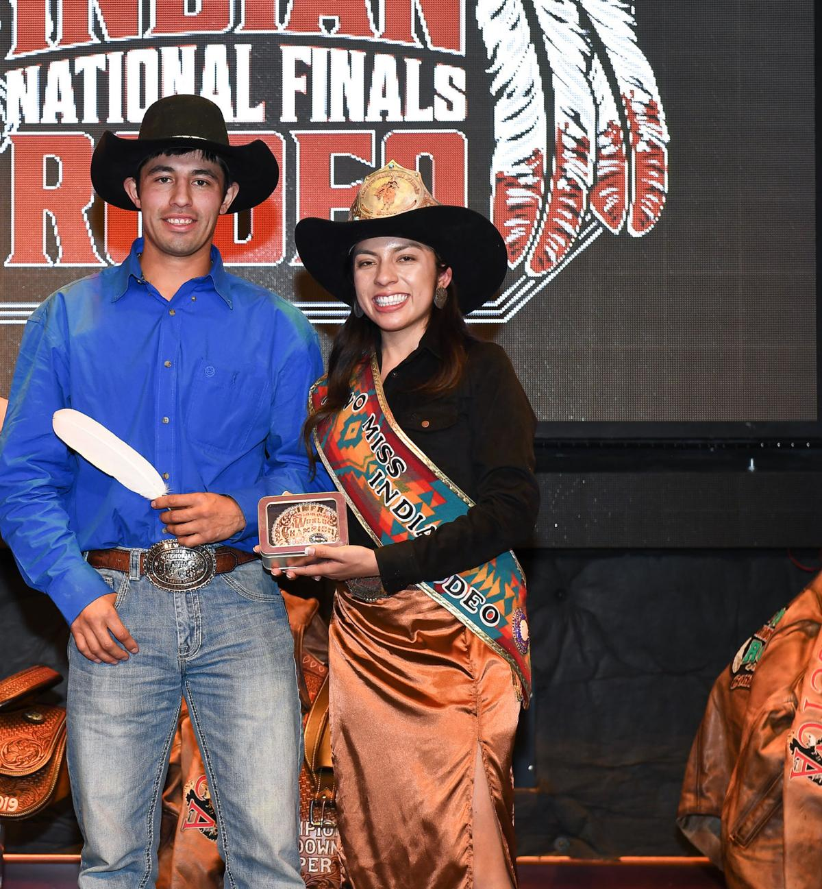 Colville tribal member Francis Marchand stands with 2020 Miss Indian Rodeo after winning the INFR All-Around buckle at the 2019 Indian National Finals Rodeo in Las Vegas October (22-26)