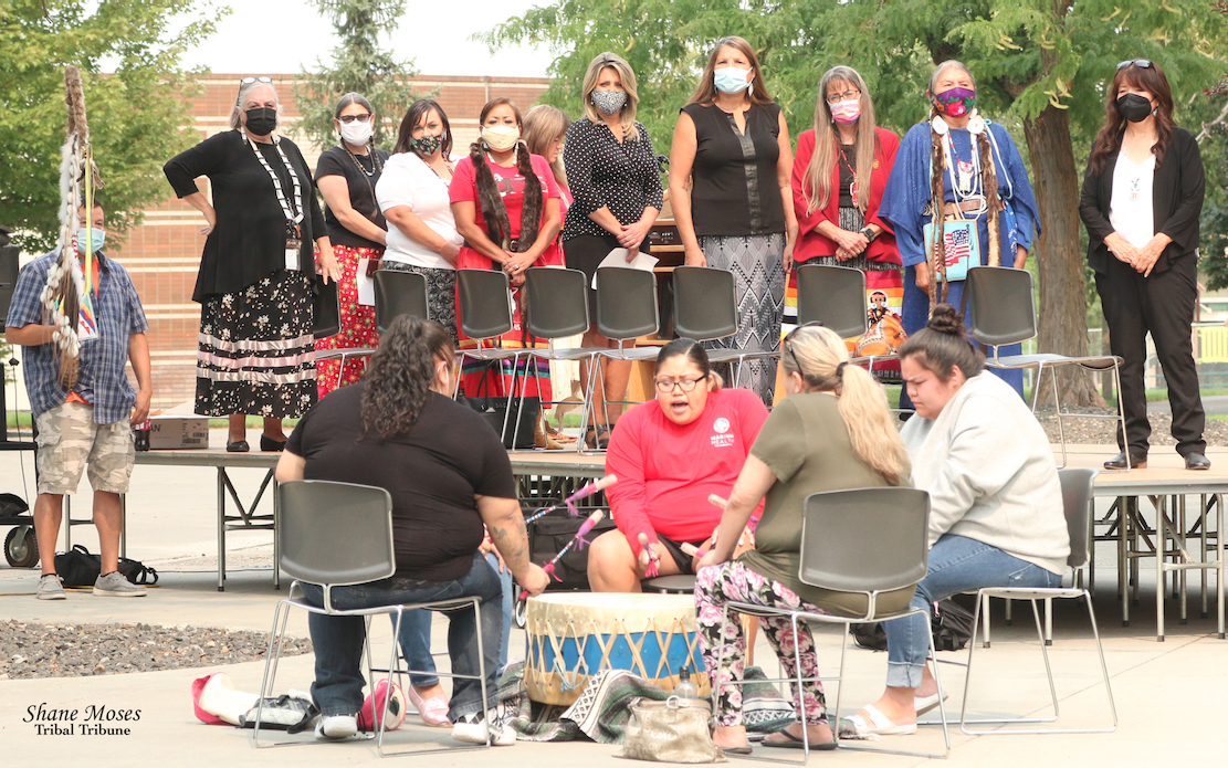 Rose Creek Singers perform outside of the library at Spokane Falls Community College on Friday (Aug. 20) afternoon to honor the name change of George Wright Drive to Whistalks Way