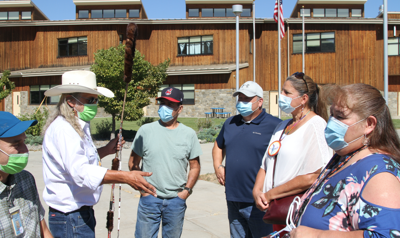 Colville Tribal member Robin Mills, a Native American Chaplain who works in Washington State Corrections institutions, presents donations made by inmates at Coyote Ridge Correctional Facility to PSIS staff and CBC members.