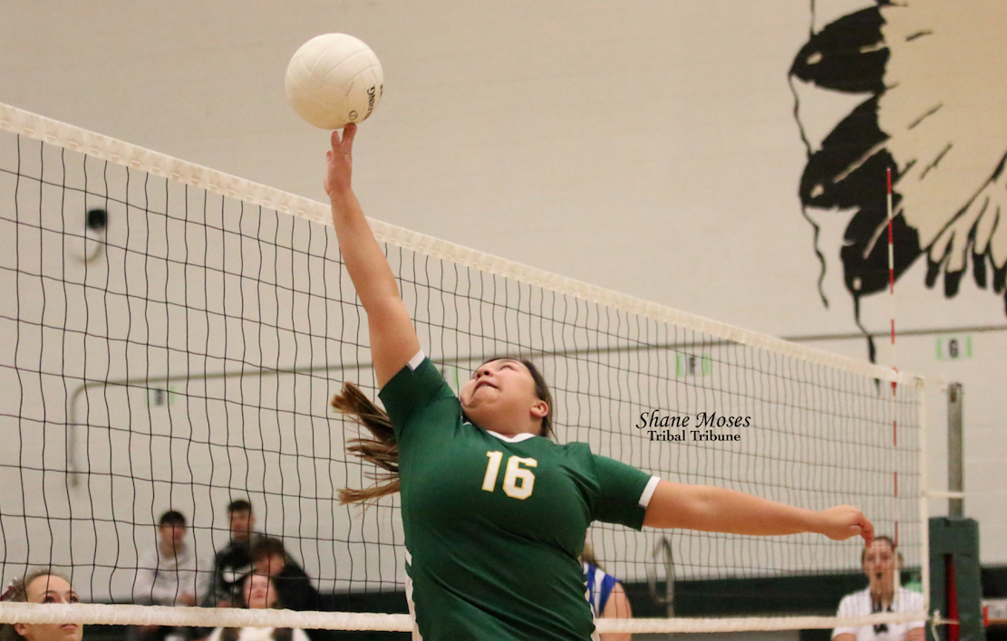 Colville tribal member Kaylee Seymour (#16) of Inchelium tips a shot over the net on Saturday (Oct. 12) afternoon against Columbia