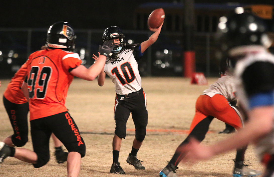Colville tribal member Darin Tonasket (#10 white) quarterback for Republic sets his feet and throws against Odessa on Saturday night in the NE 1B League Championship game. Odessa would go on to win 78-0.