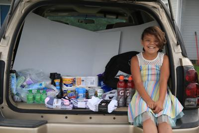Colville tribal member Amelia McCuen, 8, has set aside her summer to help homeless tribal members.