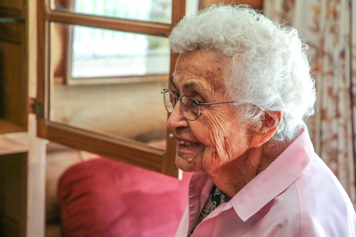 Tribal elder Wilda (Seyler) Watts smiles as she gives a tour around her 2,700 square foot home