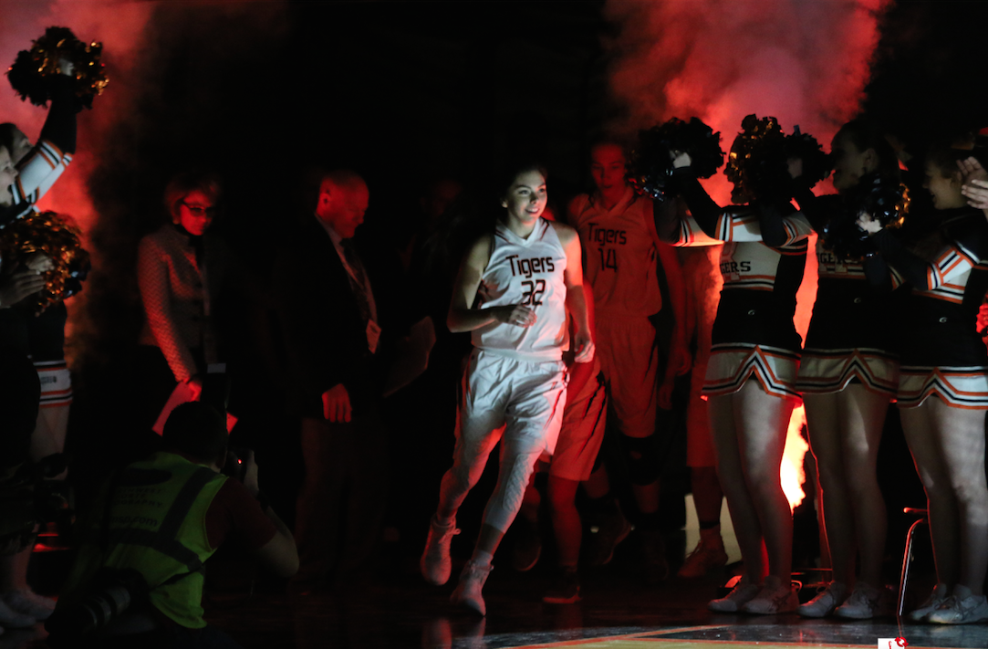 Colville tribal member Shania Graham of Republic runs out of the tunnel and into the Spokane Arena as the Tigers get set to play Almira/Coulee-Hartline in the 2017 1B Girls Hardwood Classic State Tournament Championship Game on Saturday, March 4.
