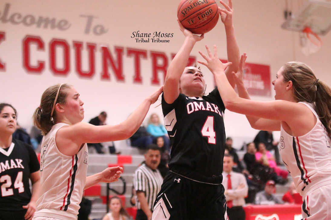 Tribal member Trinity Fjellman (#4) of Omak drives to the hoop and gets a shot up against Cascade on Friday (Jan. 17) evening. Omak won 57-11.