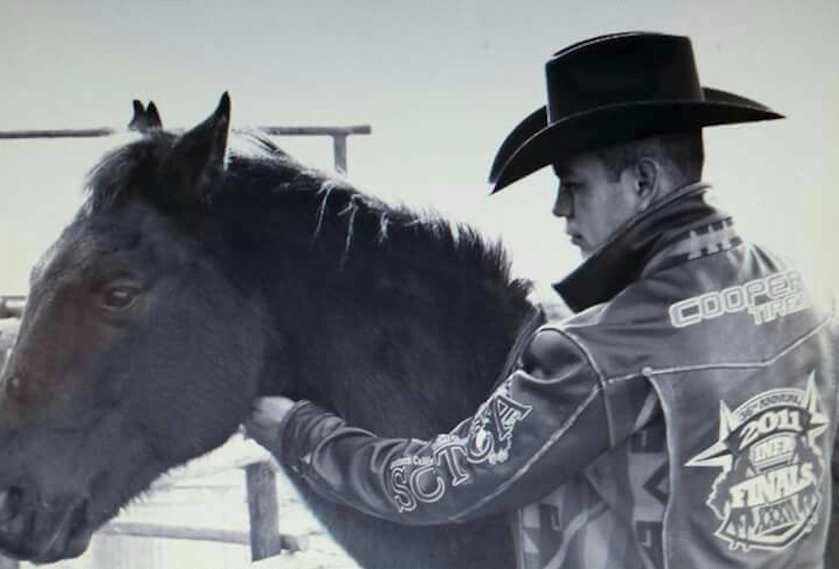 Shawn Best II pets his horse Soldier Boy at his house