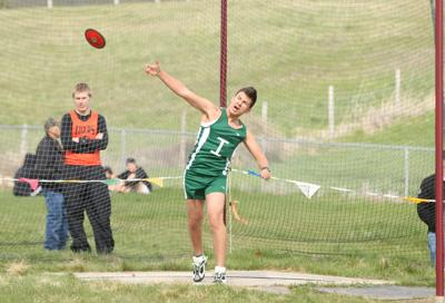 Colville tribal member Mikey Whitney throws discuss in the Inchelium home meet at Colville, Wednesday. Whitney placed eighth.