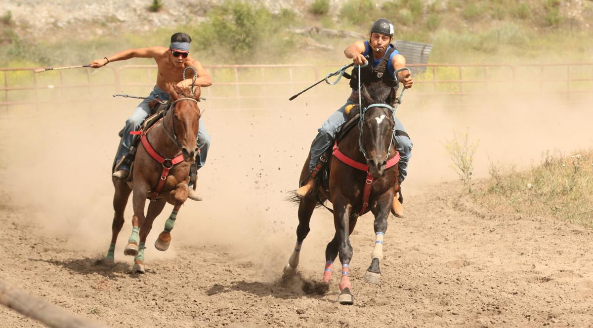 FROM LEFT TO RIGHT: Colville tribal member Matthew Pakootas trails fellow tribal member Francis Marchand in the Lucky Half Mile race this past Saturday at the Pakootas Dam Horse Races, held outside of Nespelem