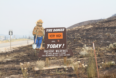 The Smokey Bear sign stands surrounded by black at the Nespelem Agency, today.
