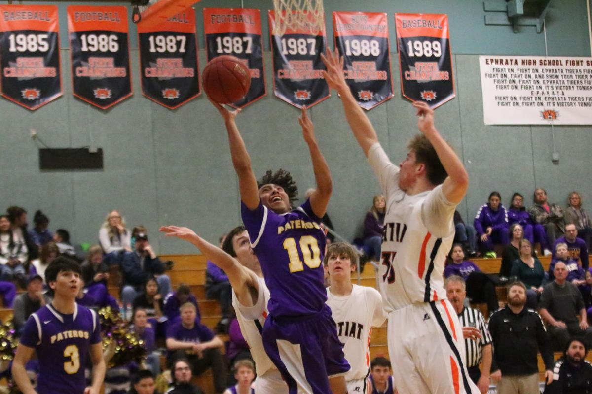 Action shots from the Pateros / Entiat boys basketball game on Friday evening in the CWA District 6 1B Boys Basketball Tournament at Ephrata High School