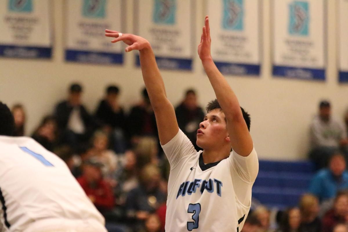 Colville tribal member Dedrick Pakootas of Spokane C.C. holds his follow through after shooting a pair of free throws against Columbia Basin on Wednesday evening in NWAC action
