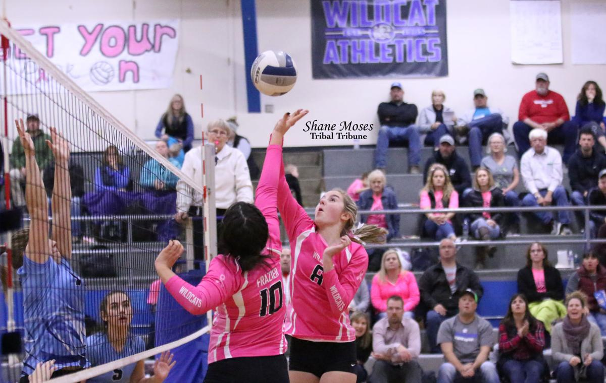 Madison Frazier (#10 pink) and Faith Bowden (#8 pink) of Wilbur-Creston both go for the ball against Chewelah on Oct. 22 in Northeast 2B North League action