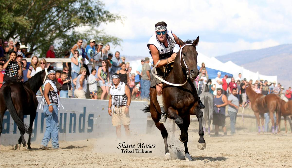 Riley Prescott jockey for Omak Express gets ready to complete his last lap at Saturday's race at the Okanogan County Fair Indian relay races