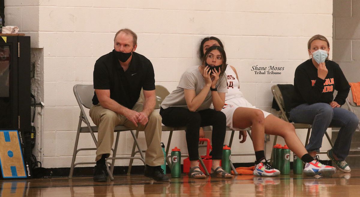 FROM LEFT TO RIGHT: Republic head coach Dan Graham, assistant coach Shania Graham, Kayla Tonasket and Republic girls basketball team manager sit and watch the game against Northport (June 14)