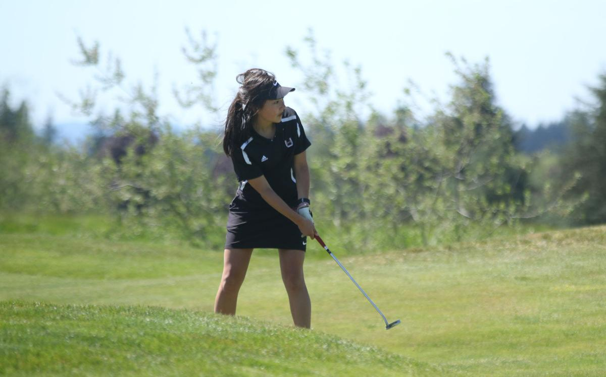 Callie Mills of Union High School chips a shot down the fairway near the green on hole 11 at the 4A GSHL District Tournament at Tri-Mountain Golf Course on May 6