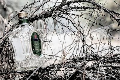 An empty bottle of Crown Royal was placed in the brush on Silver Creek Road near Keller.