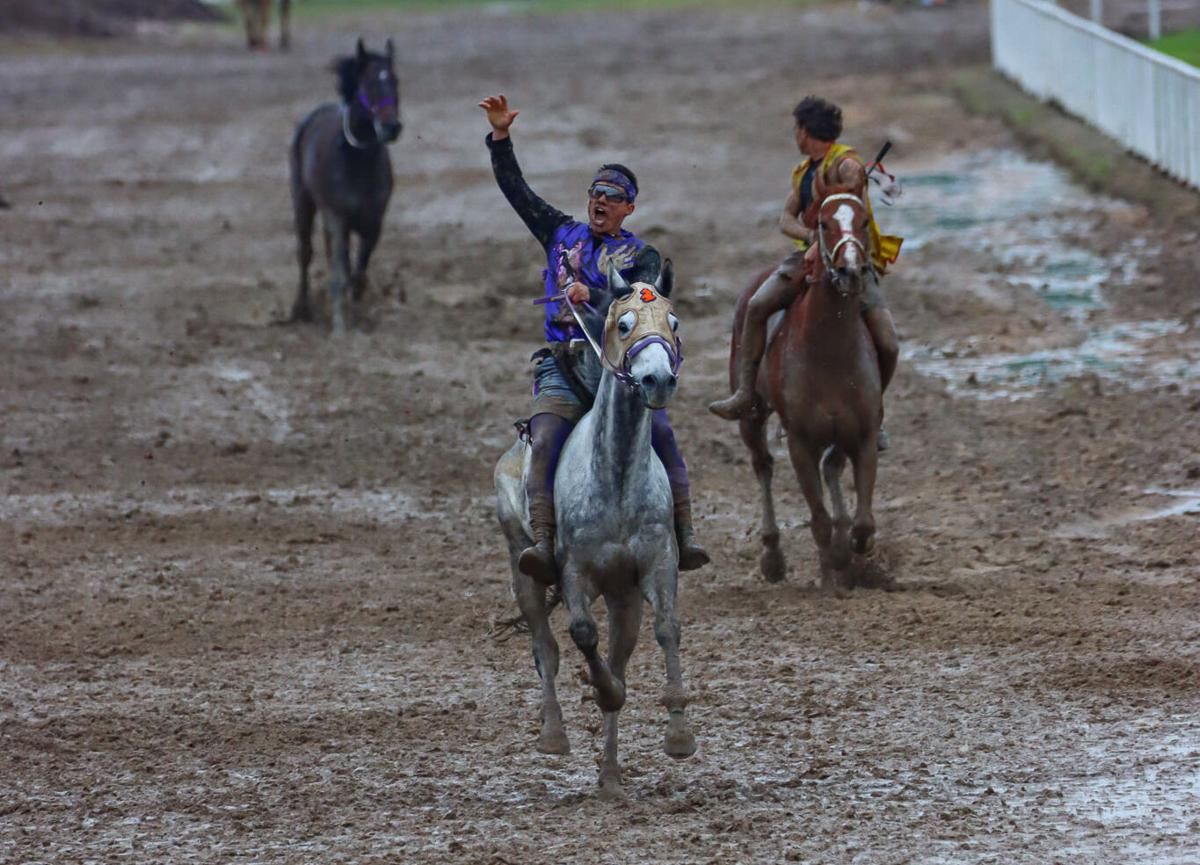 Colville tribal member Scott Abrahamson celebrates as he places first in the championship race of the International Championships in Oklahoma (May 27-31)