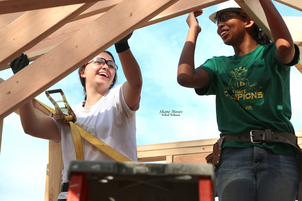 LEFT TO RIGHT: Sammi Stensgar and Zalissa Finley work on the roof of their Tiny House Project at Twin Lakes Youth Camp on the morning of Aug. 10
