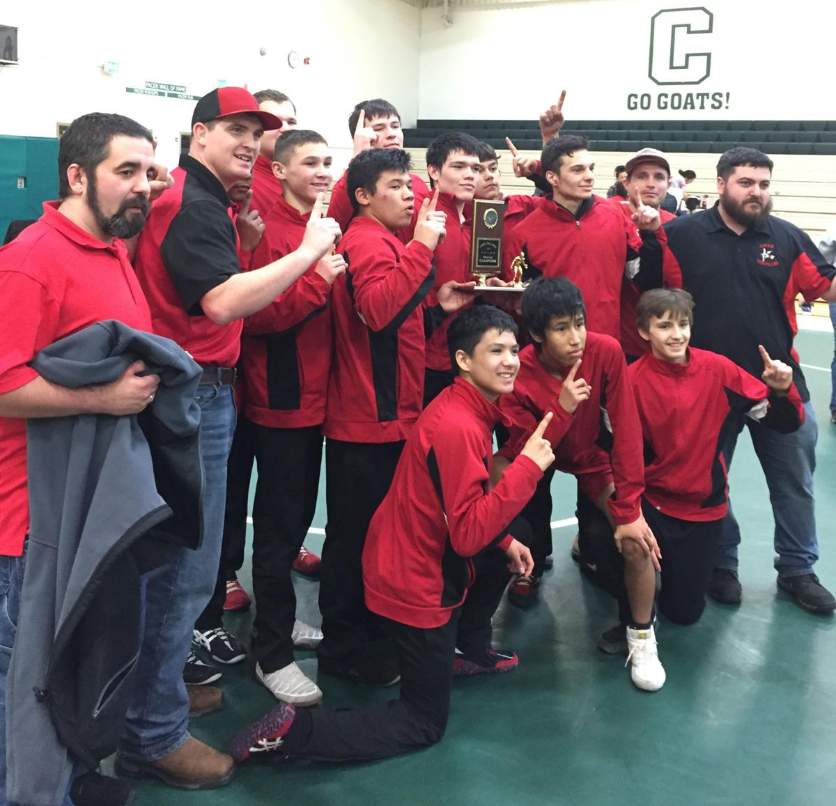 The Omak Pioneers' wrestling team claimed their league title with dual wins at Chelan on Jan. 30.