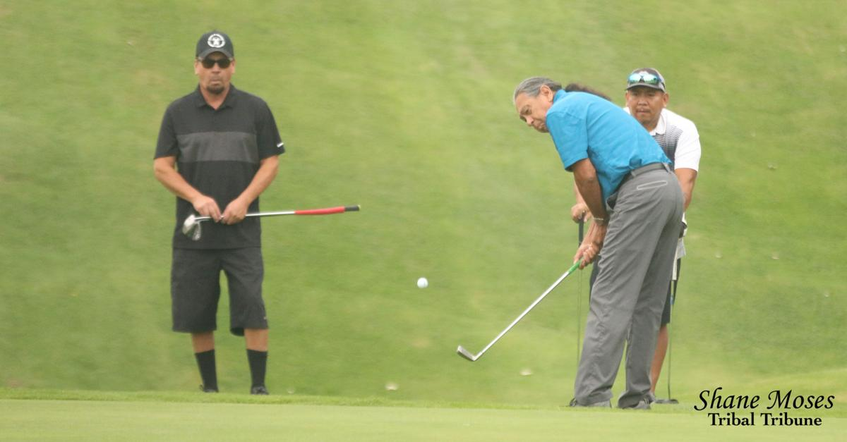 Colville tribal elder Butch Stanger chips a shot on to the green on the ninth hole at this year's 10th annual Rattler Open golf tournament from Banks Lake Golf Course on Saturday (August 25)