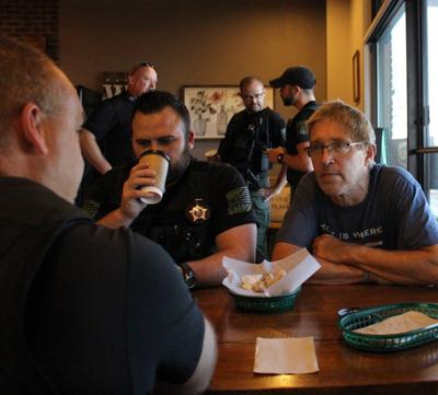 Citizens mark National Coffee with a Cop Day