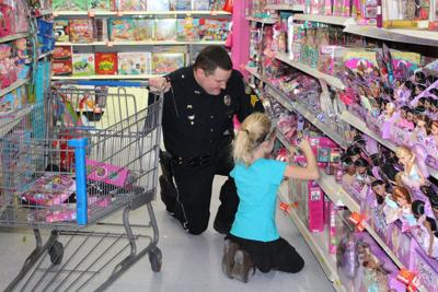 MC officers Christmas shop with kids