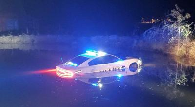 Sheriff's deputy OK after crashing car into pond