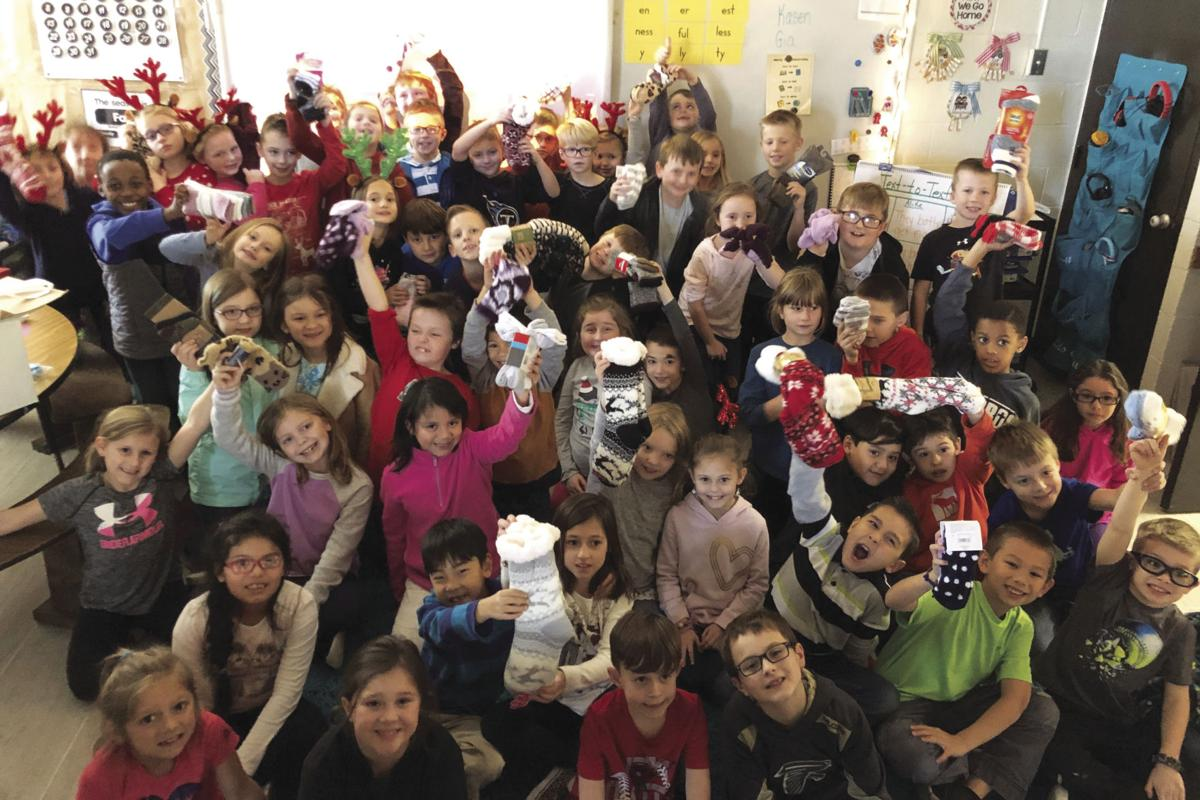 Free Home students give Christmas cards and socks to nursing home residents