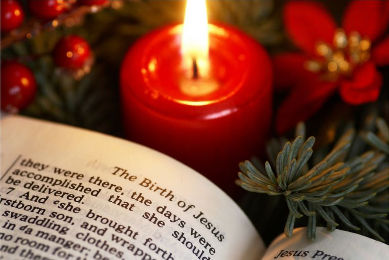 bible and candle - Biblical Christmas Story