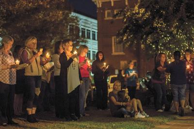 Domestic violence awareness vigil held in downtown Canton