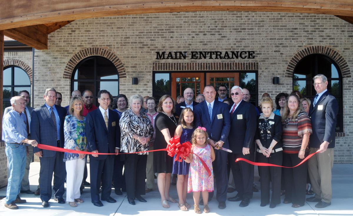 Poole Funeral Home and Cremation Services cuts ribbon, opens