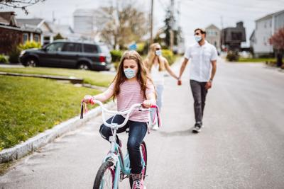 happiness family walking with bike the street during covid19