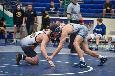 Wrestler of the Year: Higgins caps historic career with elusive state title