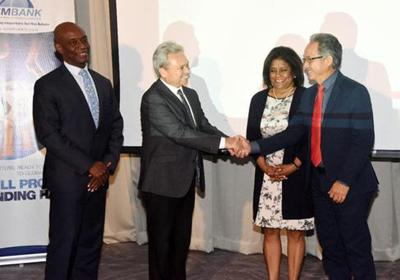 FLASHBACK, MAY 2018: Minister of Finance Colm Imbert, left, greets Eximbank chairman John Tang Nian while Minister of Trade Paula Gopee-Scoon looks on at Eximbank's press conference at the Hyatt (Trinidad) hotel in Port of Spain following the launch of the US$100 million facility.  —Photo: CURTIS CHASE