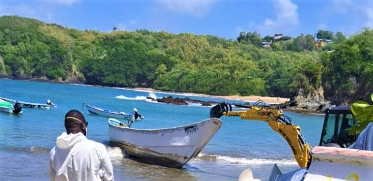 The boat containing the bodies being pulled ashore at Belle Gardens, Tobago.jpg