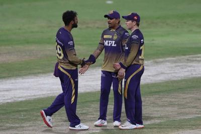 Eoin Morgan, Sunil Narine and Varun Chakaravarthy