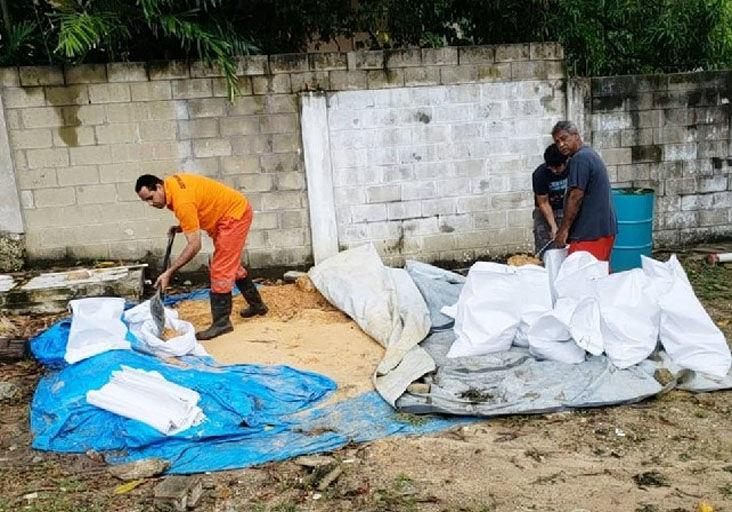 Workers fill sandbags