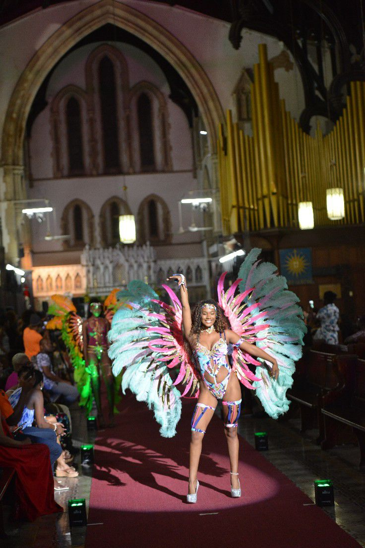 A model displays a costume from the Wee Mas Carnival band at the Holy Trinity