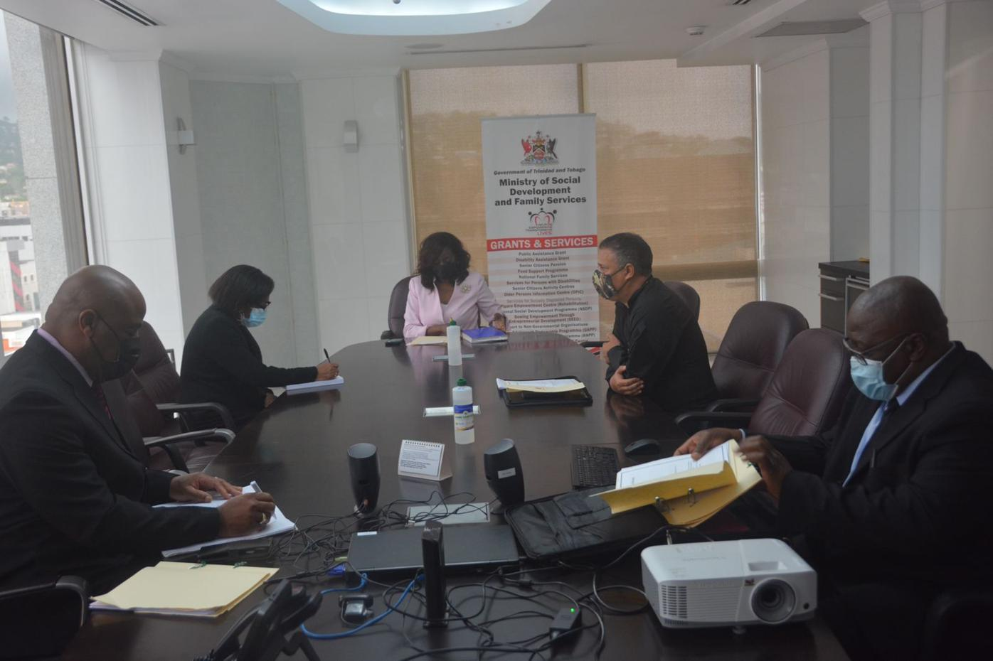 In Keen Discussion Senator The Hon Donna Cox, Minister of Social Development and Family Services meets with Commissioner of Police Gary Griffith and his team at the TTPS to discuss fraud.jpeg