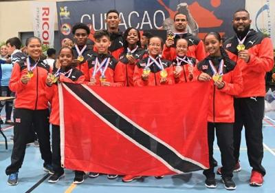 SATISFIED: Team T&T and their medal haul.