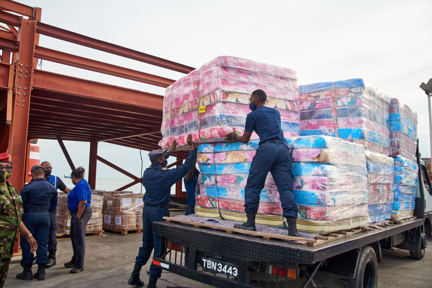 Angostura Members of the Coast Guard load mattresses onto a truck for.jpg