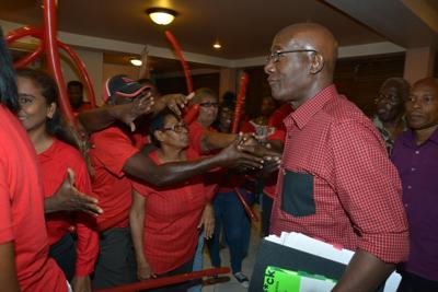 PNM supporters greet Prime Minister Dr Keith Rowley