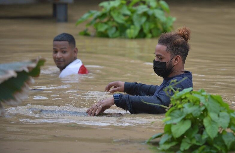 Wade through floodwaters