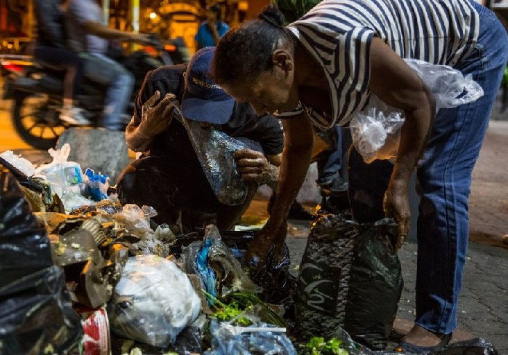 The food crisis in Venezuela has led to some scavenging through garbage for food.