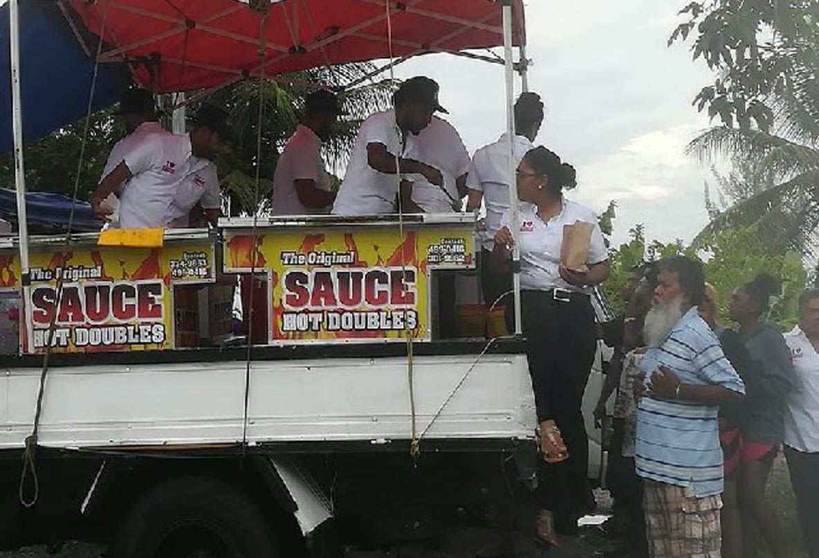 Sauce Doubles employees serving flood victims in the Kelly Village area last Sunday. Social Media Photo.